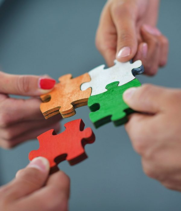 Colored puzzle pieces showing working together and team building